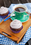 Cupcake and cup of coffee Royalty Free Stock Photos