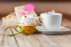 Cupcake and cup of coffee Stock Images