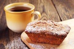 Cupcake and cup of tea Stock Photos