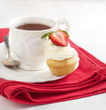 Cupcake and cup of tea Royalty Free Stock Photo