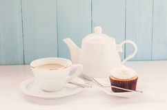 Cupcake with cup of tea and teapot Stock Photo
