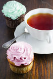 Cupcake and a cup of tea Stock Image