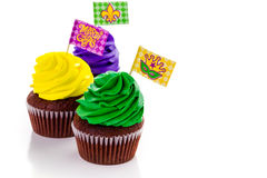 Cupcake. S decorated with bright color icing for Mardi Gras party