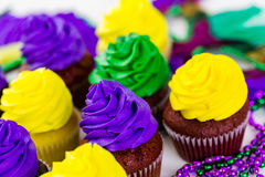 Cupcake. S decorated with bright color icing for Mardi Gras party Stock Photo