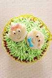 Cupcake decorated with baby faces Royalty Free Stock Photos