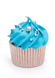 Cupcake. Decorated with blue frosting and silver dragees Stock Photos