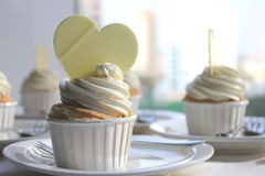 Cupcake decorated with frosting and sugar hearts. Stock Photo
