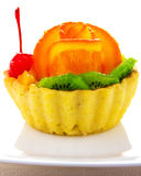 Cupcake decorated with fruit. On a white background Stock Images