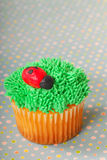 Cupcake decorated with grass frosting stock photo