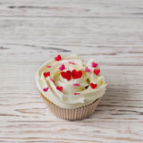 Cupcake decorated with hearts Stock Images