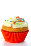Cupcake decorated with sugar sprinkles Royalty Free Stock Images