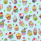 Cupcake doodle pattern. Hand drawn vector seamless pattern of cute yummy cupcakes. Can be used for fabric prints, scrapbooking, cards, design paper, backgrounds Stock Images