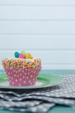 Cupcake with Easter eggs served in plate on a napkin Royalty Free Stock Photo