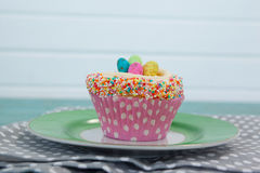 Cupcake with Easter eggs served in plate on a napkin Royalty Free Stock Photos
