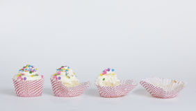 A cupcake eaten in stages stock photo