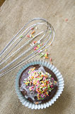 Cupcake with egg whisk Royalty Free Stock Photography
