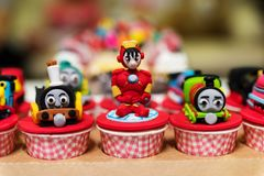 Cupcake with famous cartoon movie models Stock Images