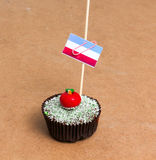 Cupcake with flag of luxemburg. Flag of luxemburg. Apple Cupcake with red apple shape bonbon on the top Stock Photography