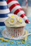 Cupcake with flowers Stock Photos