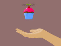 Cupcake Flying above Open Hand Royalty Free Stock Images
