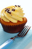 Cupcake and fork a Stock Photo