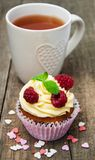 Cupcake with fresh raspberries. On a old wooden table Stock Photos
