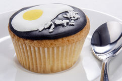 Cupcake with fried egg and grated coconut Royalty Free Stock Photography