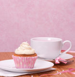 Cupcake And Fruit Tea Cup. On Wooden Background Royalty Free Stock Photography