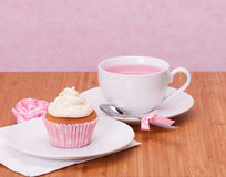 Cupcake And Fruit Tea Cup. On Wooden Background Stock Photography