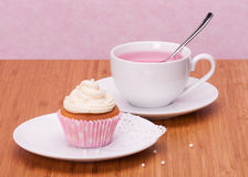 Cupcake And Fruit Tea Cup. On Wooden Background Stock Image