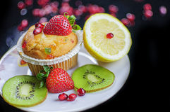 Cupcake and fruits Stock Image