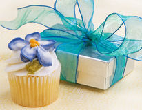 Cupcake With Gift On Yellow Royalty Free Stock Images