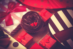 Cupcake and gifts Stock Photography