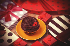 Cupcake and gifts Royalty Free Stock Photo