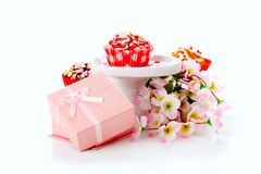 Cupcake and gifts in box Stock Photos