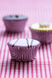 Cupcake on gingham table cloth Stock Photography