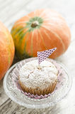 Cupcake on glass plate. pumpkin background Stock Images