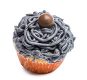 Cupcake with gray icing against white background Stock Photography