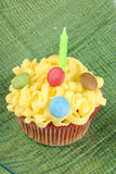 Cupcake with green candle Stock Photos
