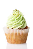 Cupcake with green cream isolated on white Royalty Free Stock Image