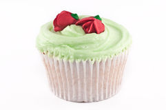 Cupcake with green frosting Stock Photos