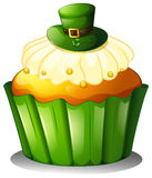 A cupcake with a green hat Royalty Free Stock Photos