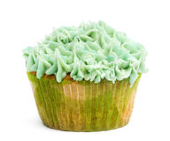 Cupcake with green icing against white background Royalty Free Stock Photography