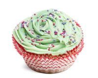 Cupcake with green icing and hundreds and thousands against white background Royalty Free Stock Photos