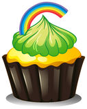 A cupcake with a green icing Royalty Free Stock Photos