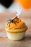 Cupcake with halloween decoration on table Stock Photo
