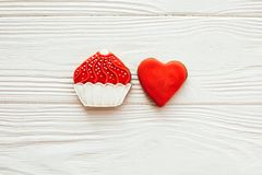 Cupcake and heart icing cookies on white wood, flat lay with space for text. Delicious sweets. Happy Mothers day. Valentine day stock photography