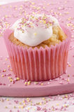 Cupcake with icing and colored sprinkles Stock Photography