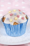 Cupcake with icing and colorful stars Royalty Free Stock Image