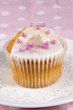 Cupcake with icing and pink pearls Stock Photos